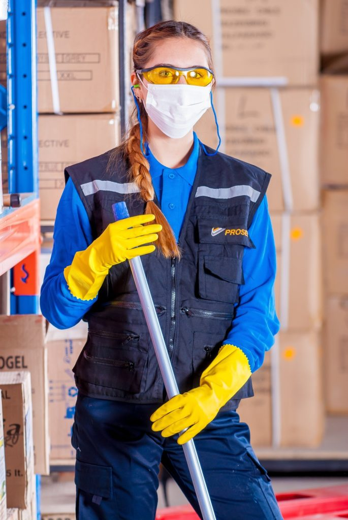 female warehouse staff worker in PPE