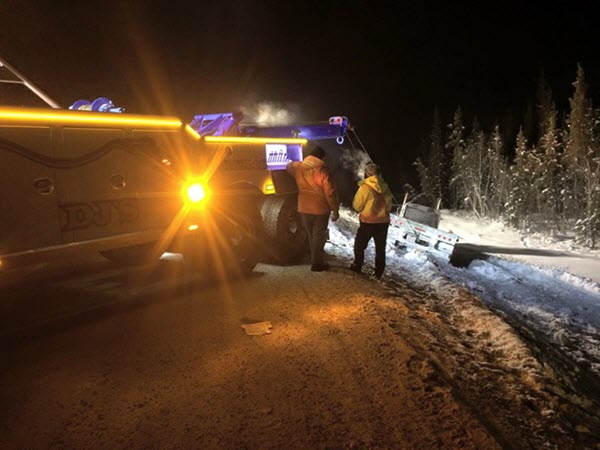 Semi-Truck Being Towed Out Of A Ditch