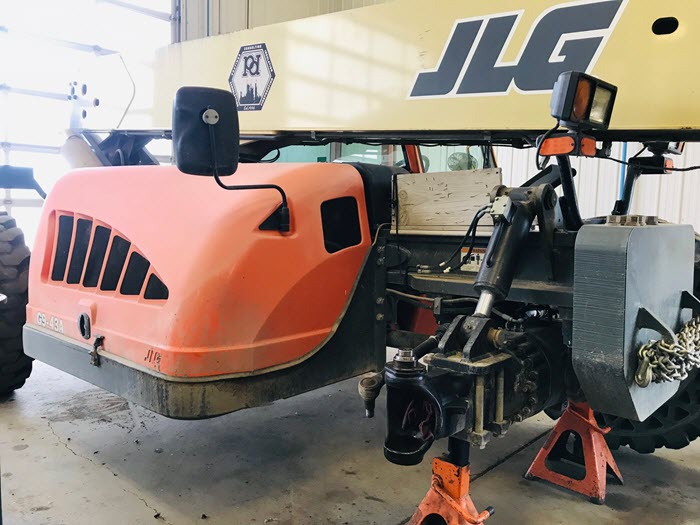 scissor lift being repaired in the Major Overhaul shop