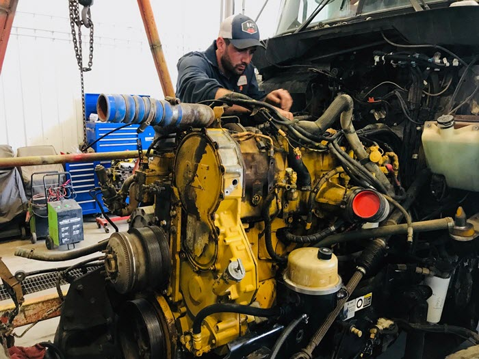 semi-truck engine being overhauled in major overhaul shop